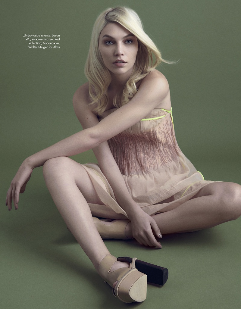 Model Aline Weber poses in Jason Wu dress and Red Valentino platforms