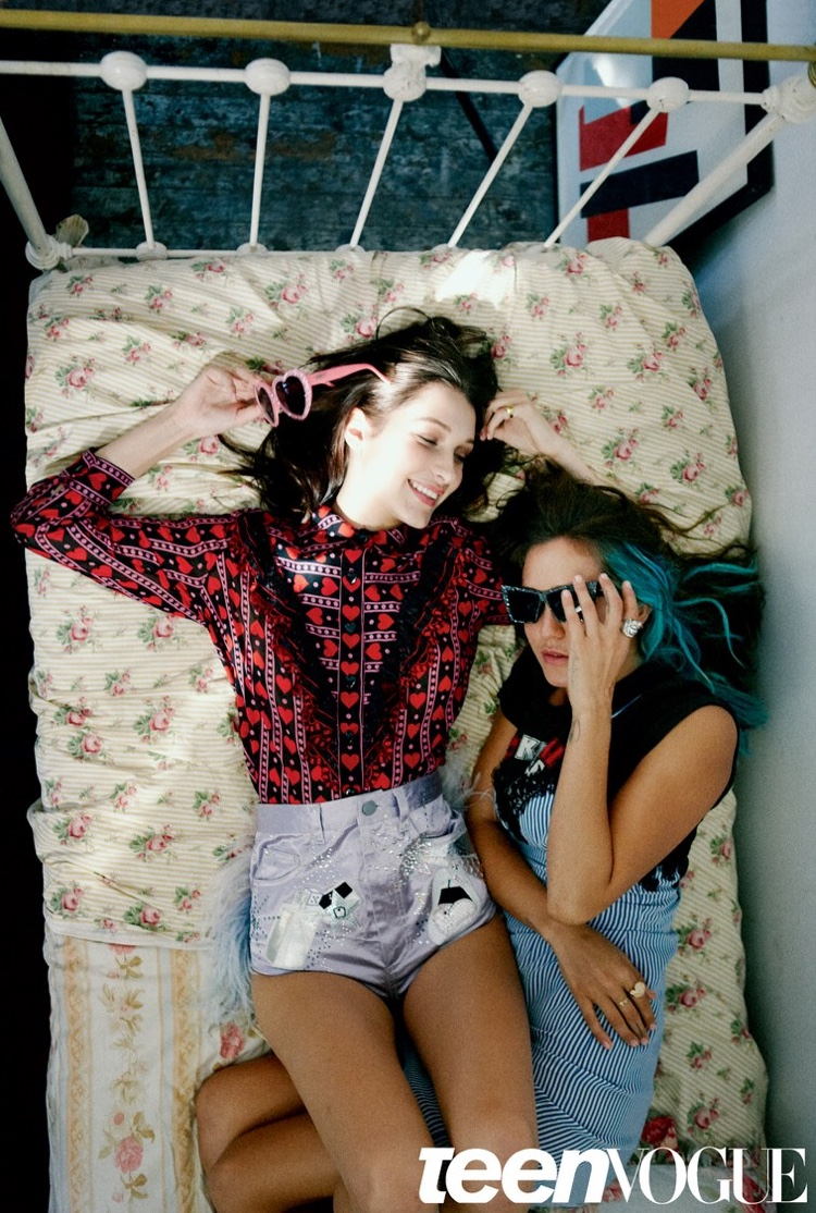 Bella Hadid poses in bed with heart print shirt and metallic shorts