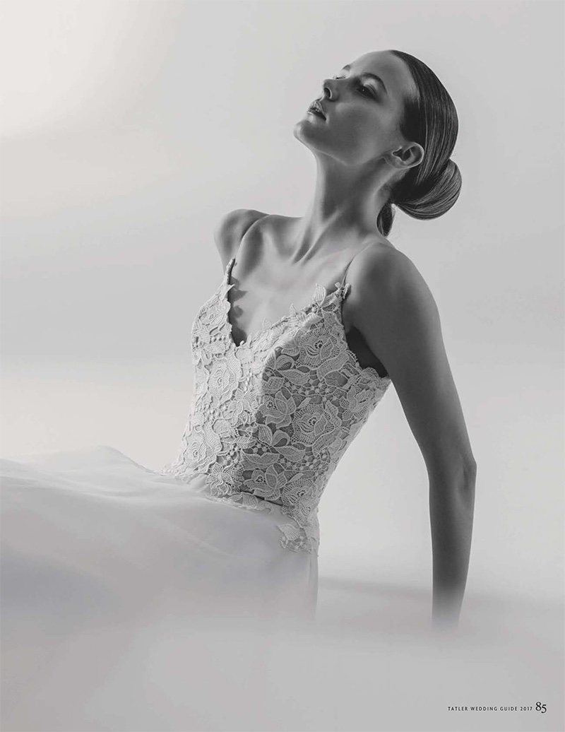 Model poses in lace and silk-organza dress from Caroline Castigliano