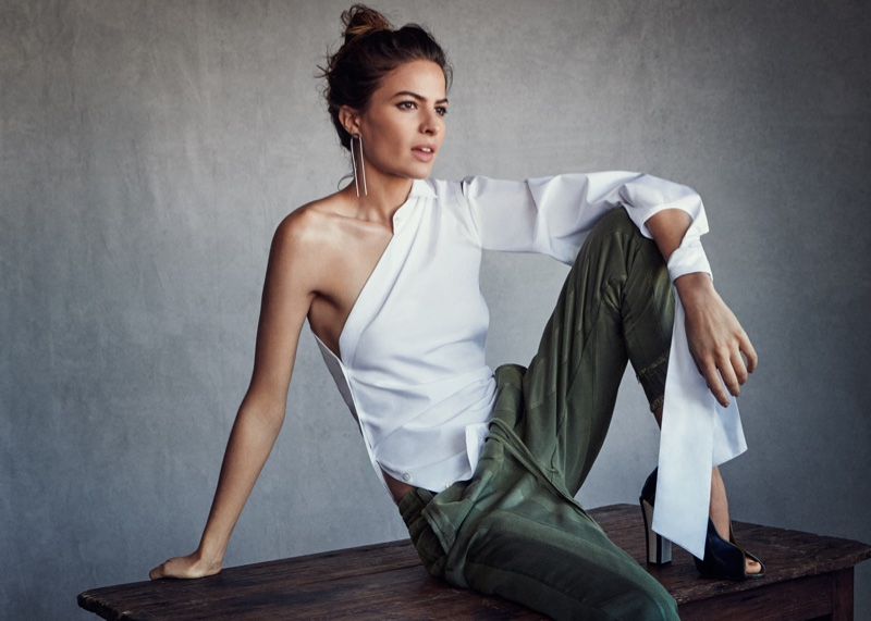 Model Cameron Russell poses in Jennifer Fisher earrings, Ann Demeulemeester top, Haider Ackermann pants and Isabel Marant heels