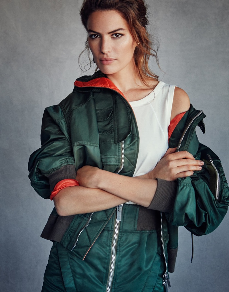Rocking green, Cameron Russell wears Sacai bomber jacket and skirt with Chloe top