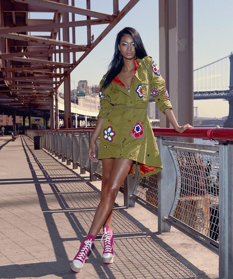 Chanel Iman wears khaki jacket with floral embellishments from Moschino