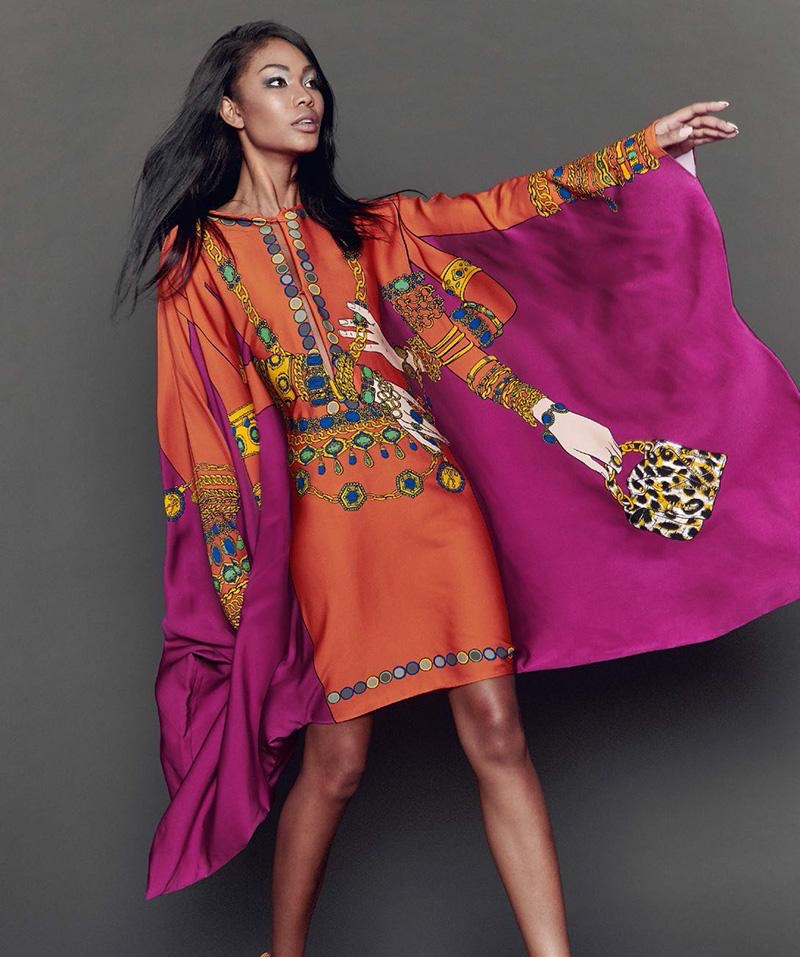 Model Chanel Iman wears embroidered caftan from Moschino