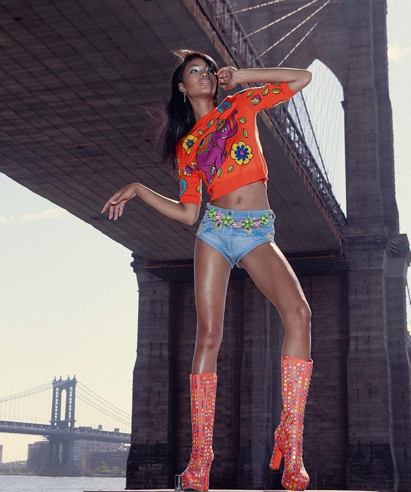 Chanel Iman models Moschino cropped sweater, denim shorts and platform boots
