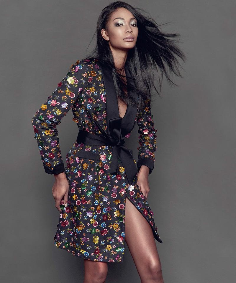 Model Chanel Iman wears Moschino embellished coat tied at the waist