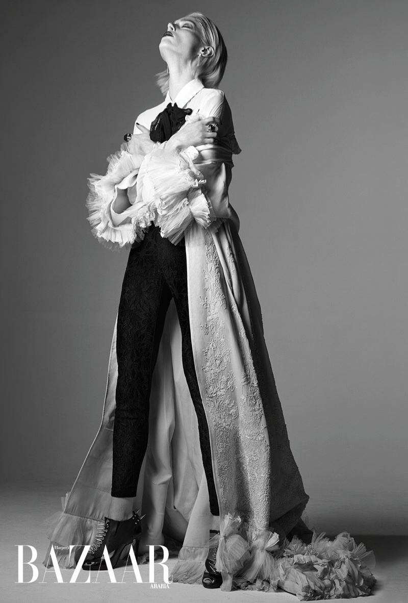 Photographed in black and white, Coco Rocha wears layered looks for the feature