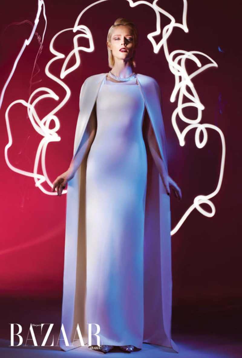 Looking beyond elegant, Coco Rocha wears white cape and gown