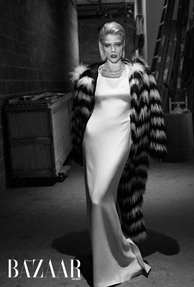Looking like a movie star, Coco Rocha wears fur coat and white gown