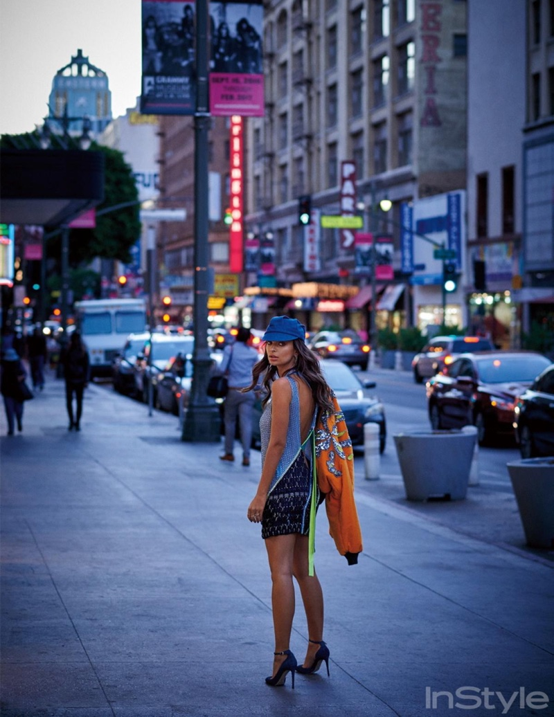 Hitting the streets, Emily Ratajkowski wears Marc Jacobs bomber jacket, Versace beaded dress and Jimmy Choo pumps