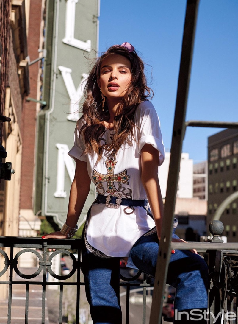 Emily Ratajkowski models Dolce & Gabbana embellished t-shirt and earrings with Rihanna x Manolo Blahnk denim chaps boots