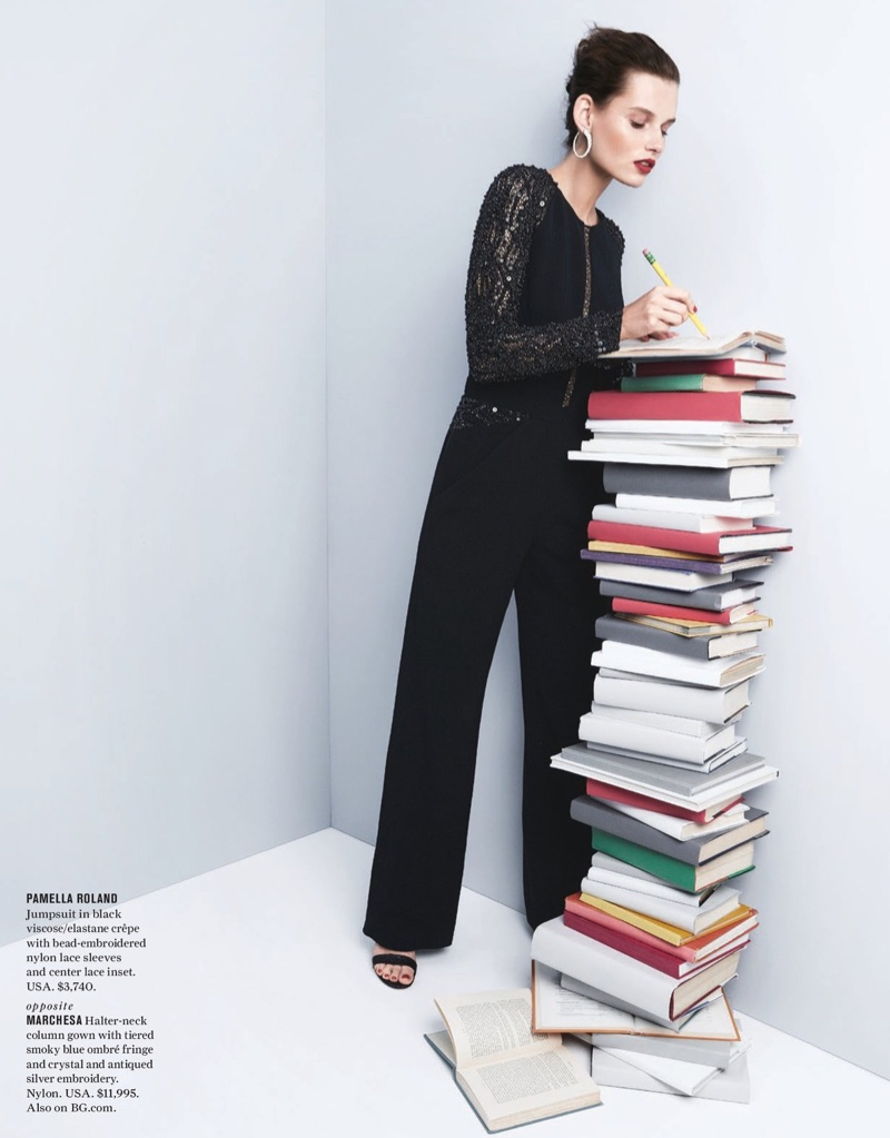 Checking her book list, the model wears Pamella Roland jumpsuit