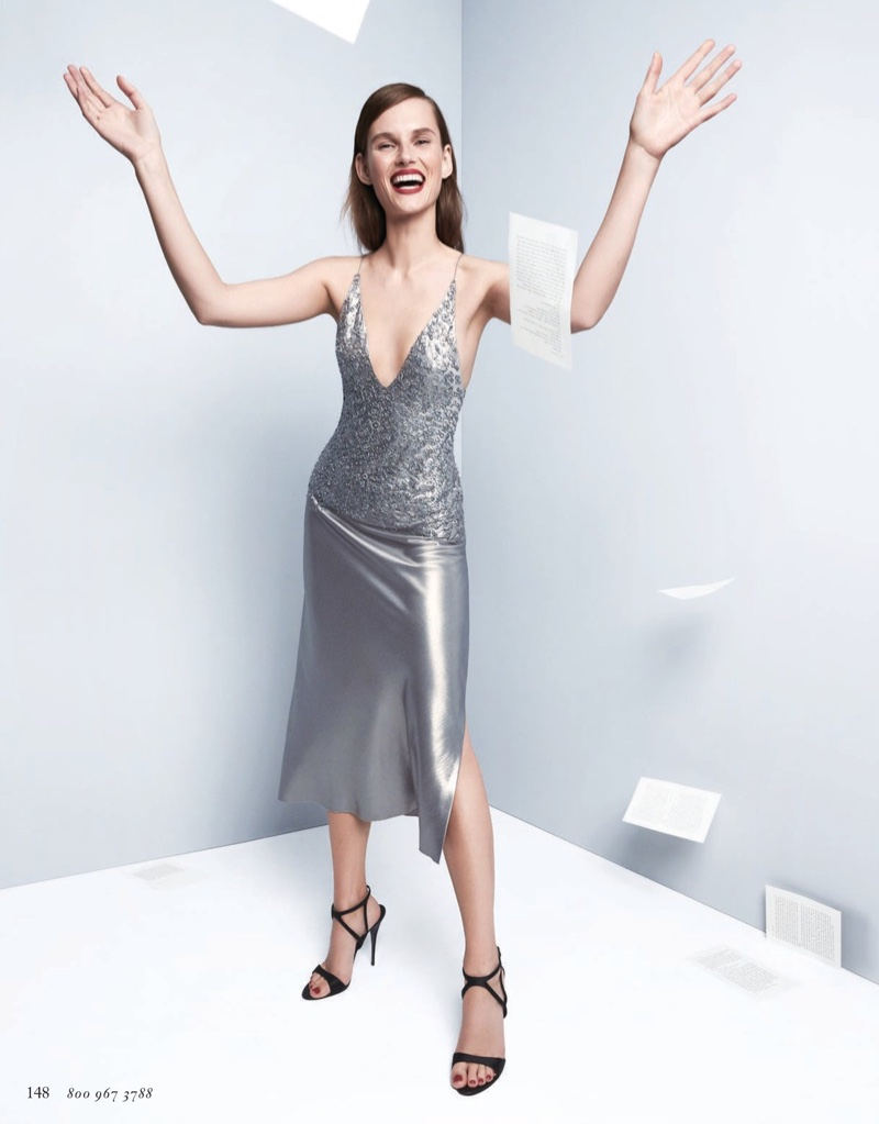 Giedre Dukauskaite poses in Narciso Rodriguez dress with metal-embroidered bodice