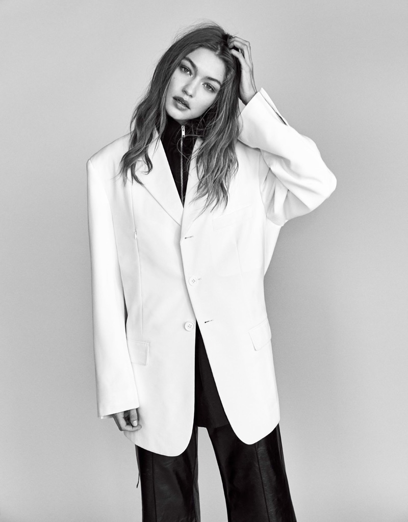 Photographed in black and white, Gigi Hadid models oversized jacket and slim-cut trousers