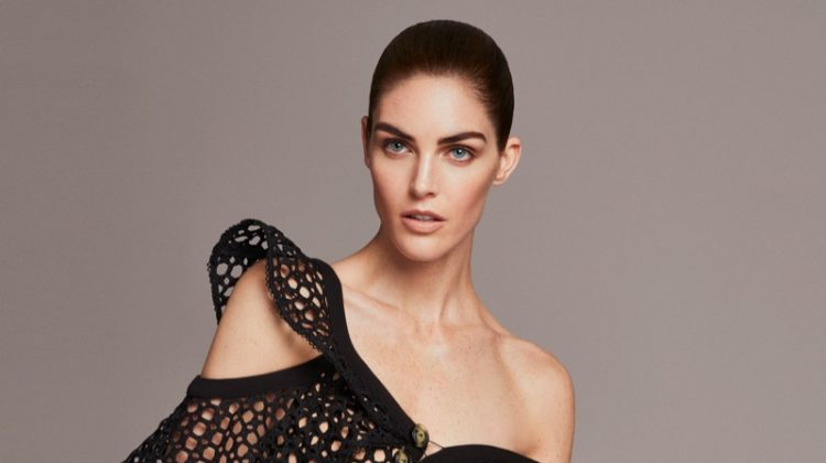 Hilary Rhoda wears sculpted top and high-waisted trousers