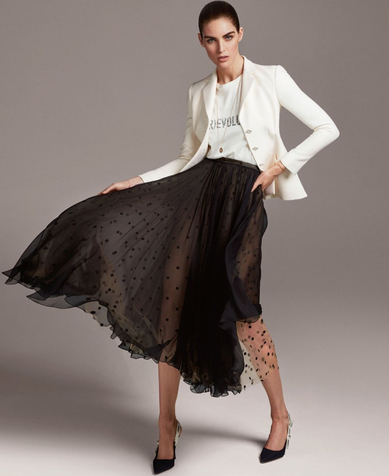 Hilary Rhoda poses in Dior jacket, t-shirt and skirt