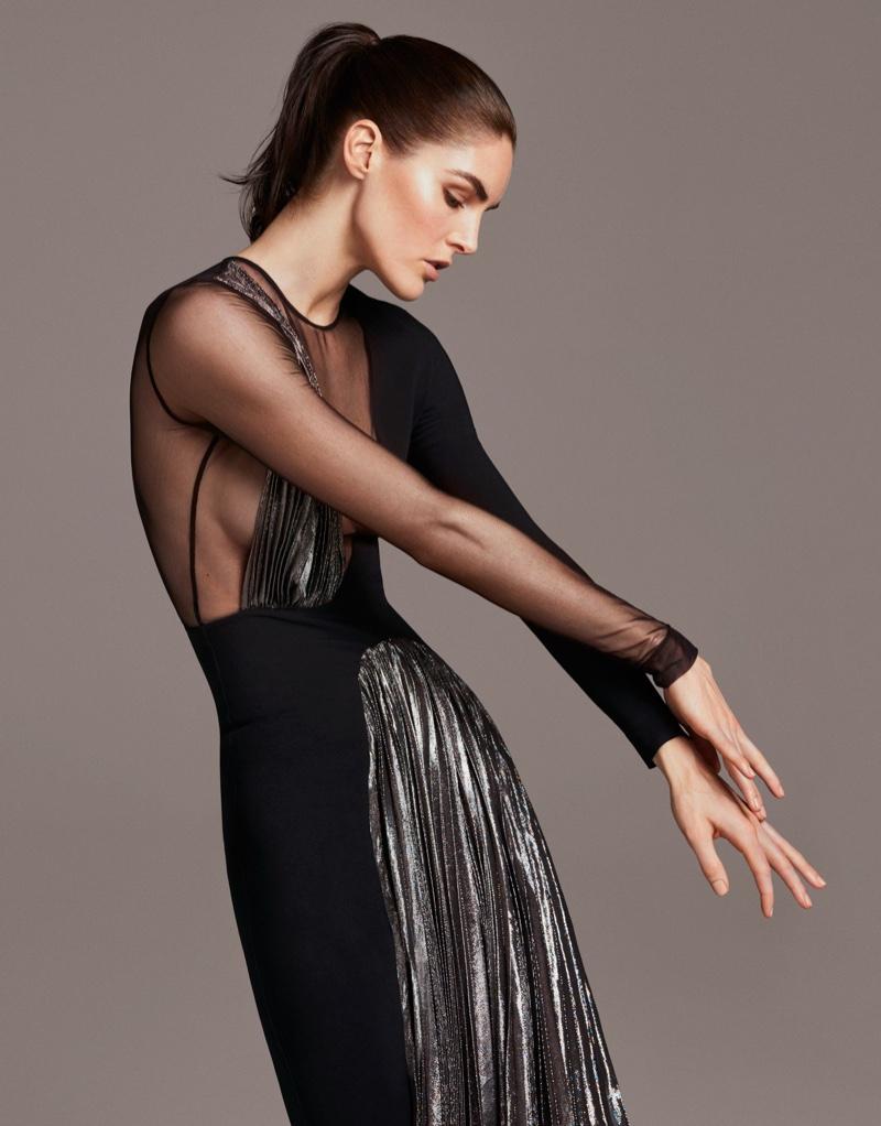 Model Hilary Rhoda poses in pleated dress