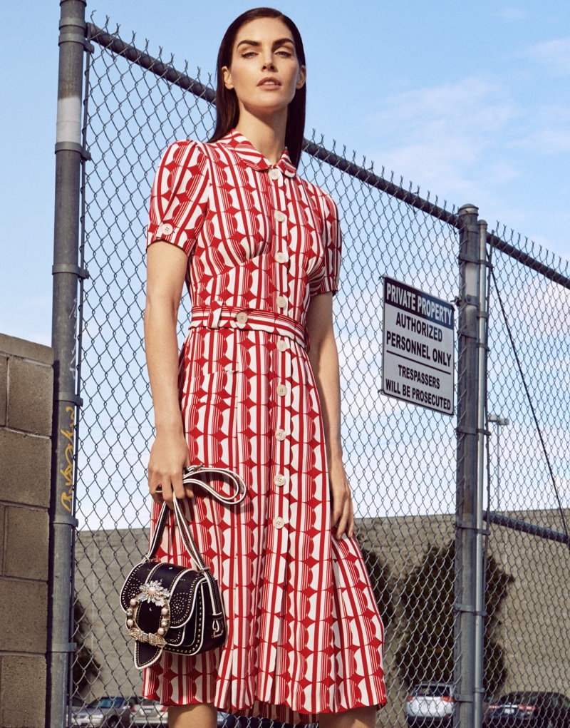 Hilary Rhoda models Miu Miu dress and bag