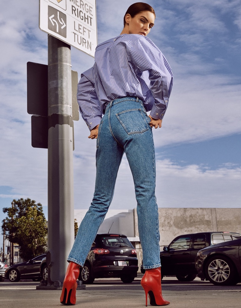 Taking a turn, Hilary Rhoda models Balenciaga shirt, jeans and boots