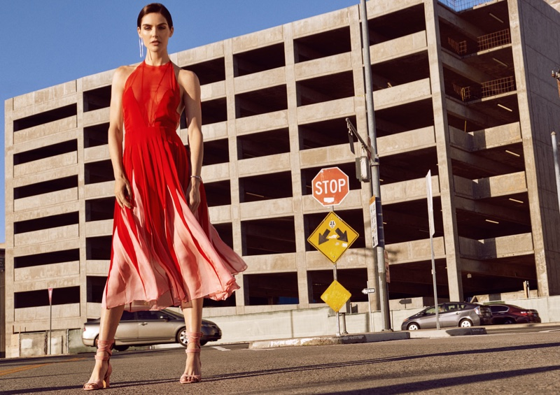 Standing tall, Hilary Rhoda models Valentino dress and sandals with Jennifer Fisher jewelry