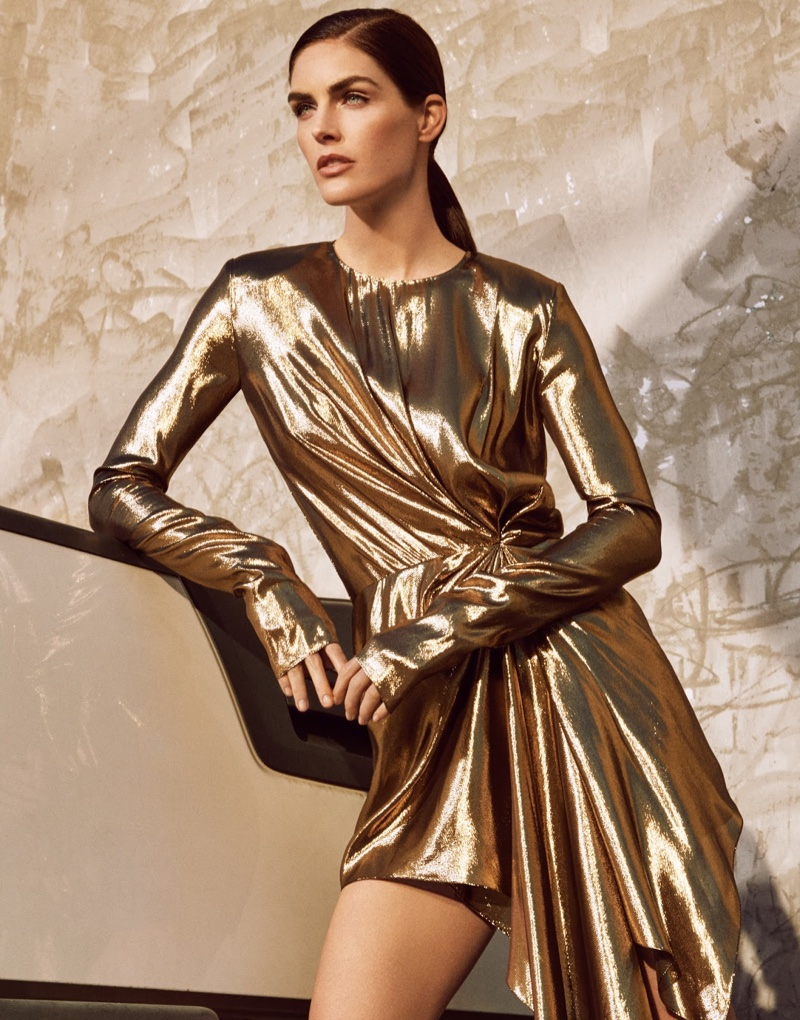 Shining in gold, Hilary Rhoda models Saint Laurent metallic dress