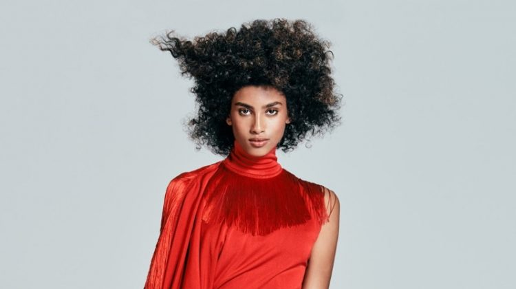 Embracing fringe, Imaan Hammam poses in Givenchy dress with Falke tights
