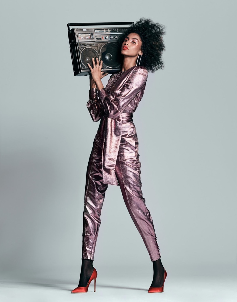 Imaan Hammam wears Hillier Bartley jumpsuit and Gianvito Rossi pumps