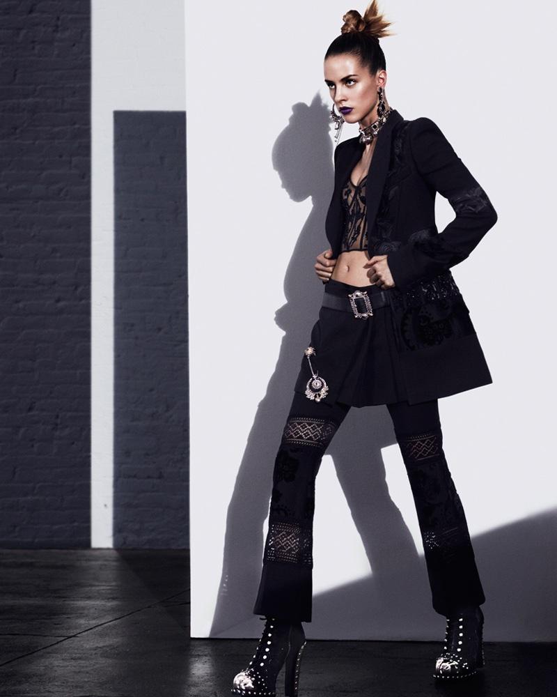 Suiting up, Julia Frauche models Alexander McQueen jacket, corset, trousers and platform boots