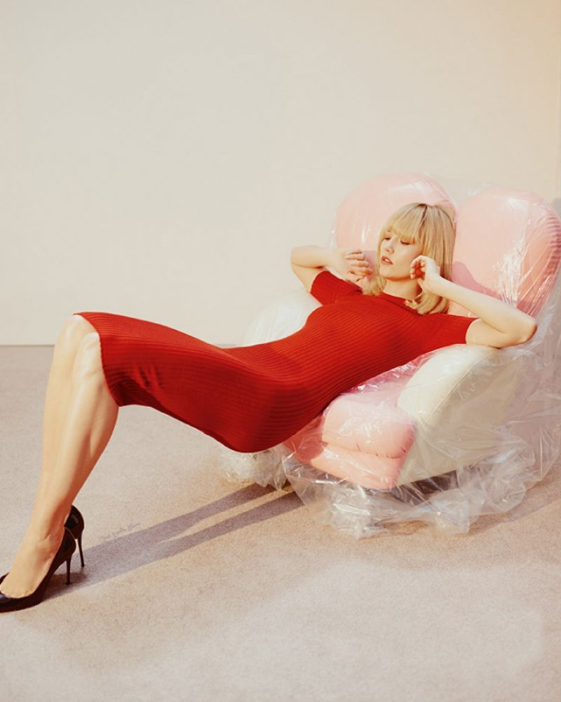 Karlie Kloss lounges in a red ribbed-knit dress