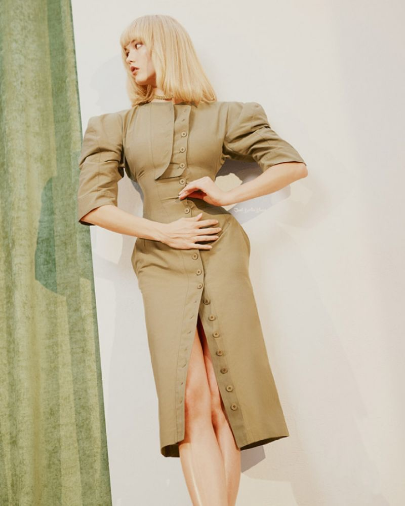 Striking a pose, Karlie Kloss models a fitted jacket dress