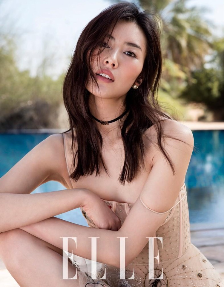 Model Liu Wen poses in Dior dress