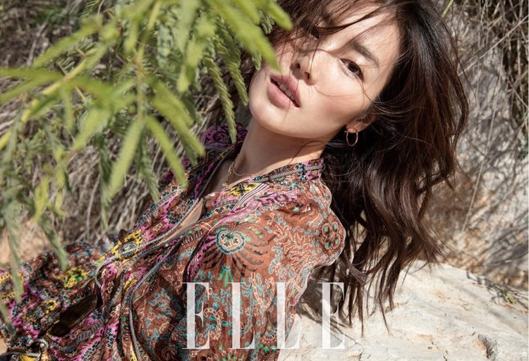 Getting her closeup, Liu Wen wears her hair in playful waves