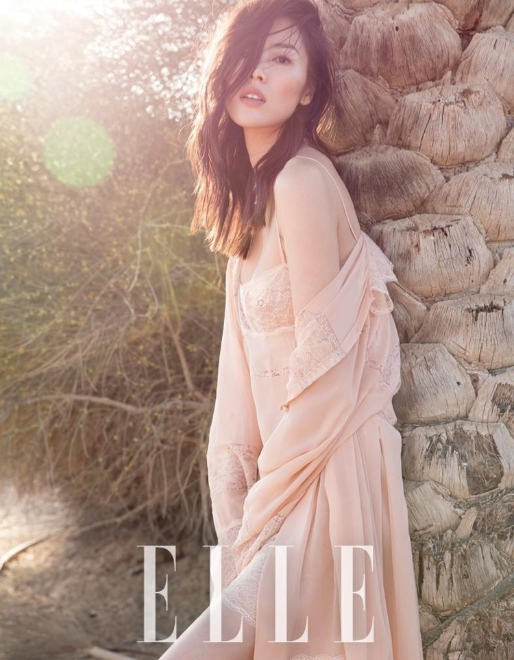 Liu Wen poses in lace robe and slip dress