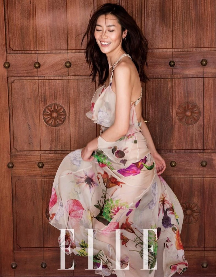 Model Liu Wen wears floral print dress