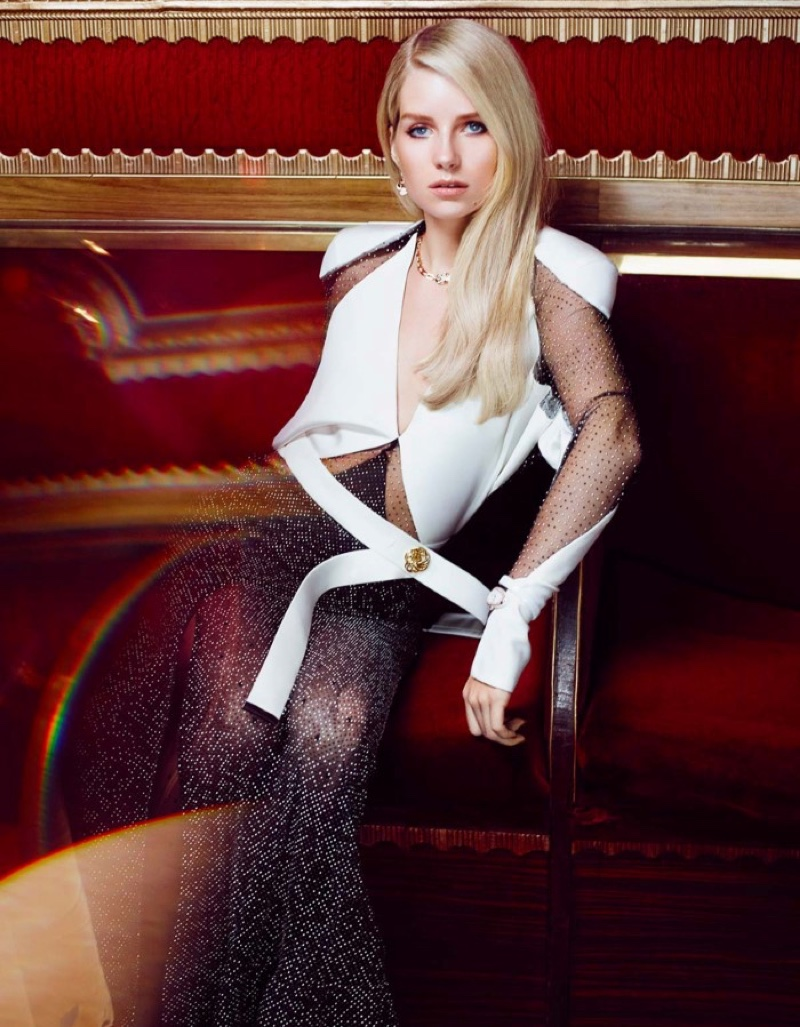 Model Lottie Moss poses in Louis Vuitton dress with Bulgari jewelry