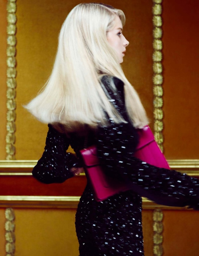 Lottie Moss poses in Michael Kors Collection dress and Bulgari handbag