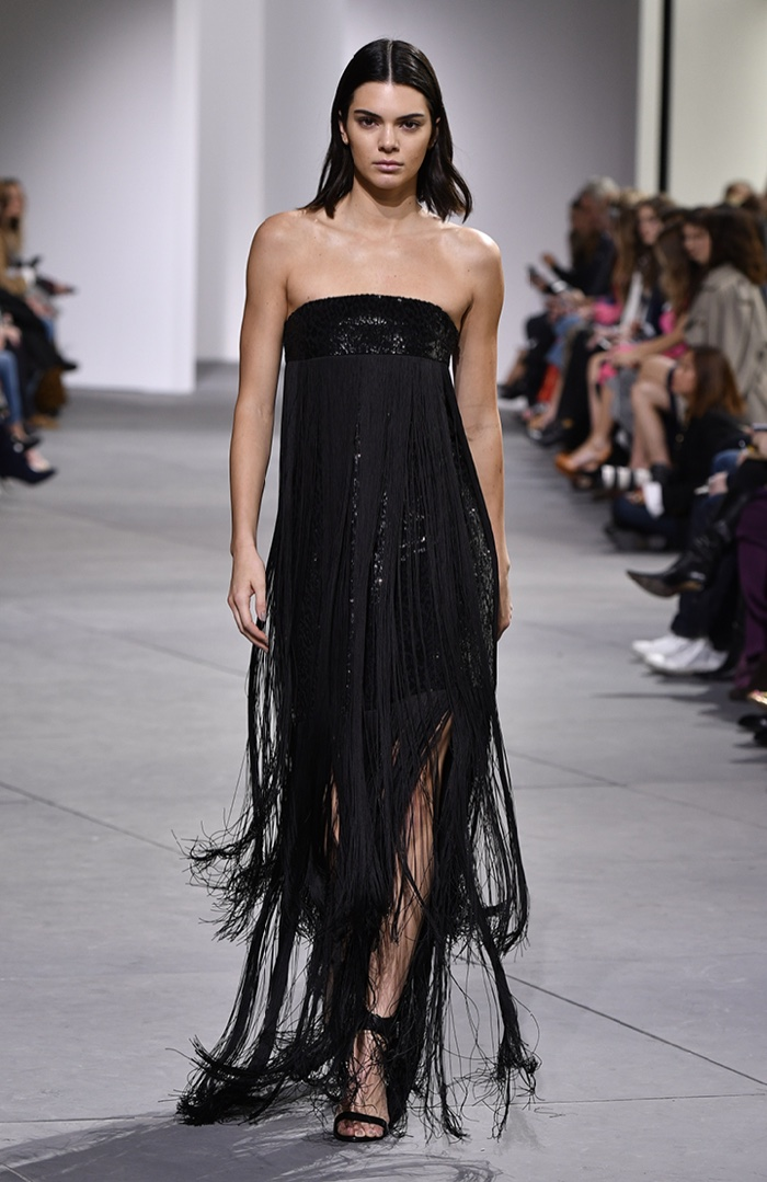 Kendall Jenner wears fringe embellished strapless dress from Michael Kors Collection fall-winter 2017