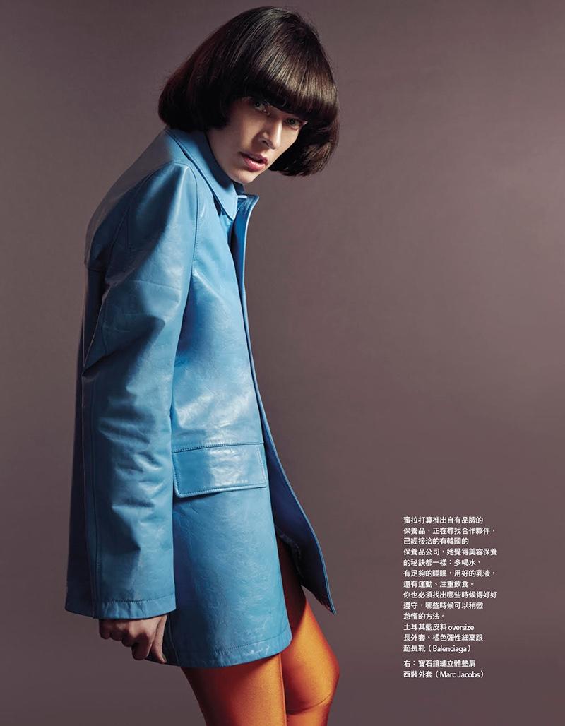 Milla Jovovich poses in Balenciaga oversized jacket and leggings