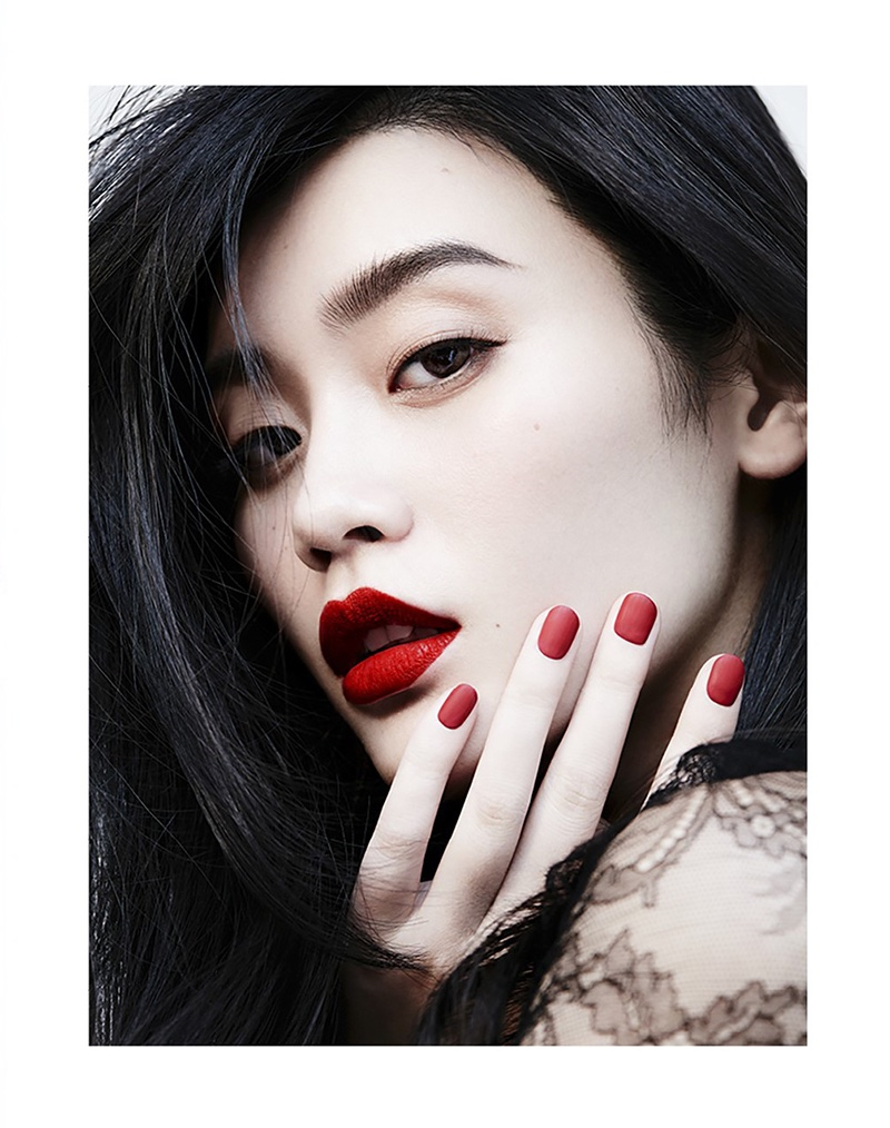 Getting a closeup, Ming Xi shows off red lipstick with a matching manicure