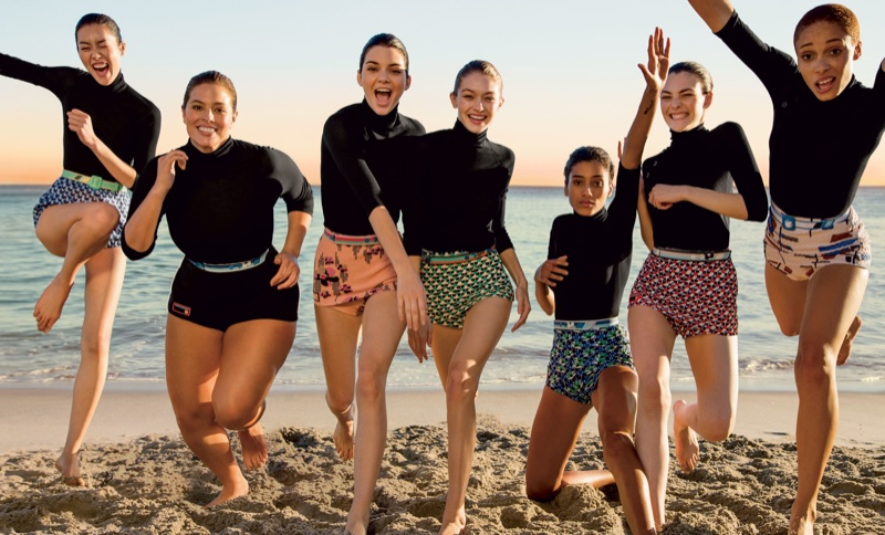Liu Wen, Ashley Graham, Kendall Jenner, Gigi Hadid, Imaan Hammam, Adwoa Aboah and Vittoria Ceretti wear Prada turtlenecks and shorts. Liu wears Miu Miu shorts.