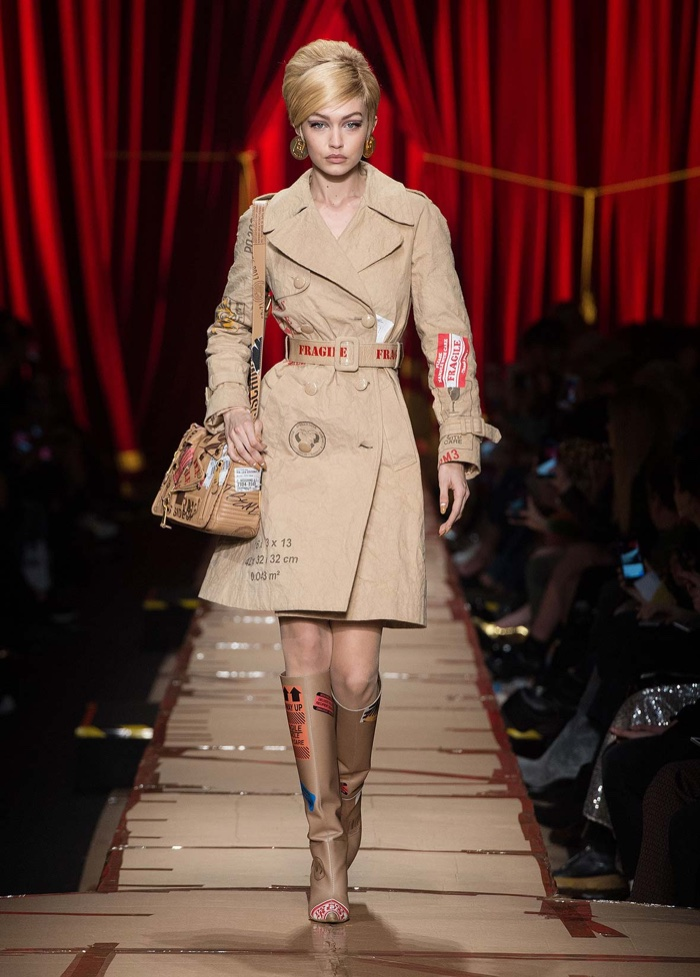 Gigi Hadid wears cardboard inspired trench coat from Moschino's fall-winter 2017 collection