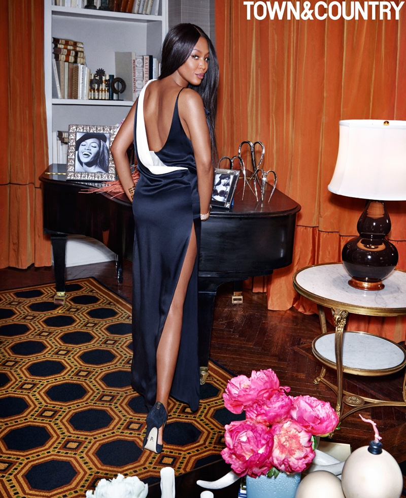 Posing in a Lanvin gown, Naomi Campbell glitters in Belperron cuffs and Cartier bracelet