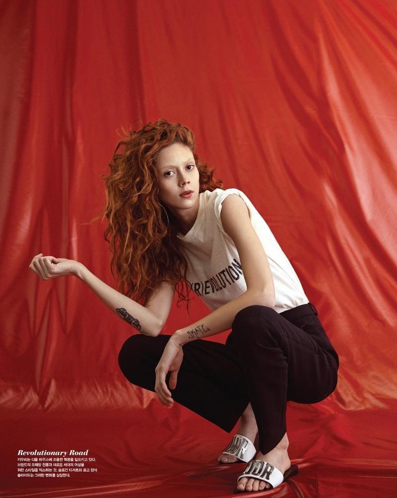 Model Natalie Westling wears Dior t-shirt, black pants and slide sandals