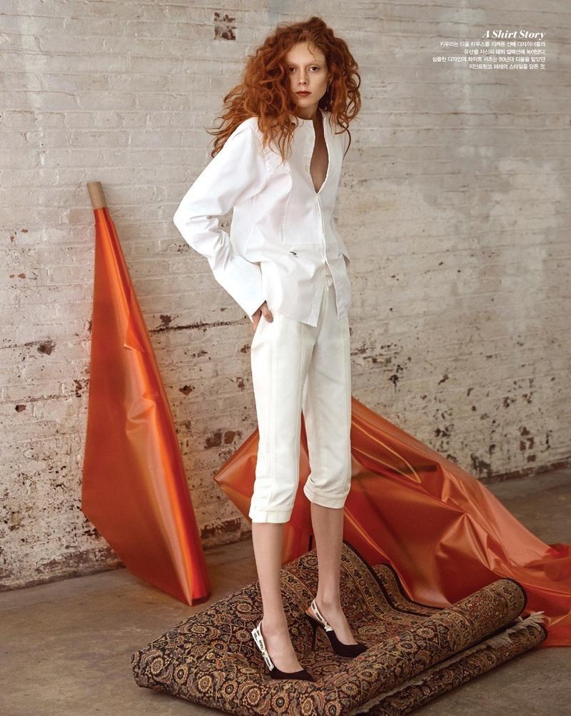 Dressed all in white, Natalie Westling models Dior