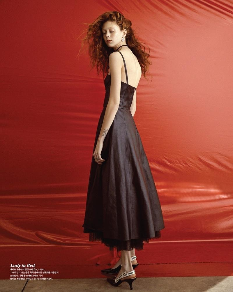 Wearing a black dress, Natalie Westling poses in Dior with heels