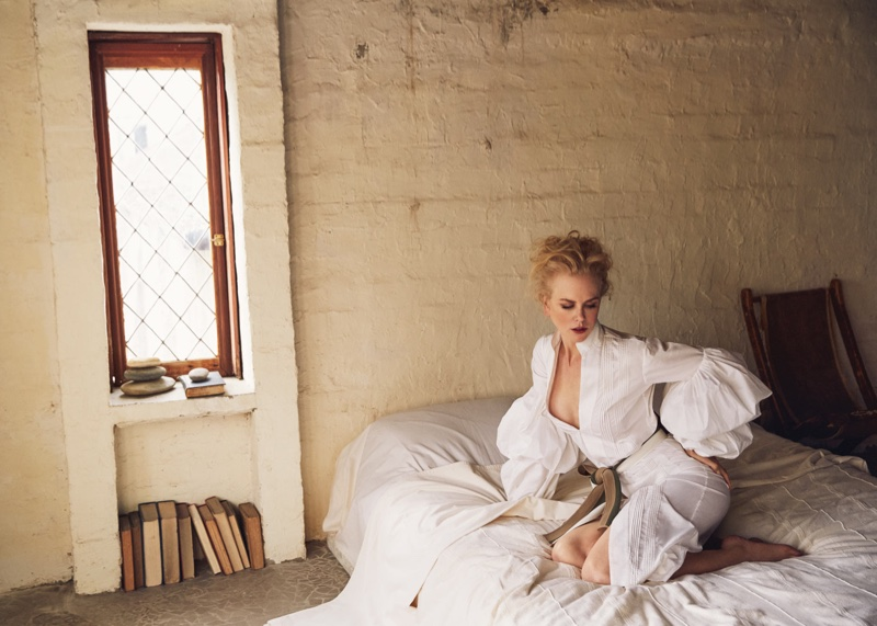 Posing in bed, Nicole Kidman wears Johanna Ortiz dress and belt