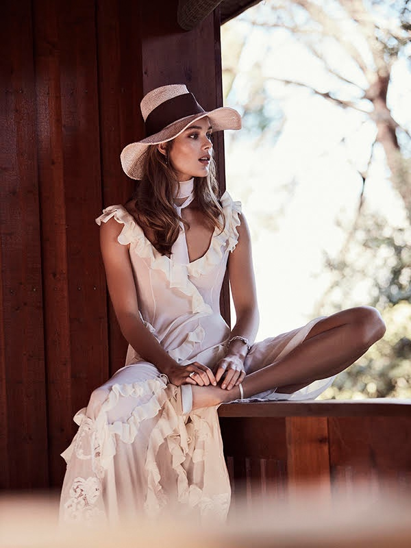 Rozanne Verduin wears Miguel Crespe dress, Mimoki hat and Jimmy Choo heels