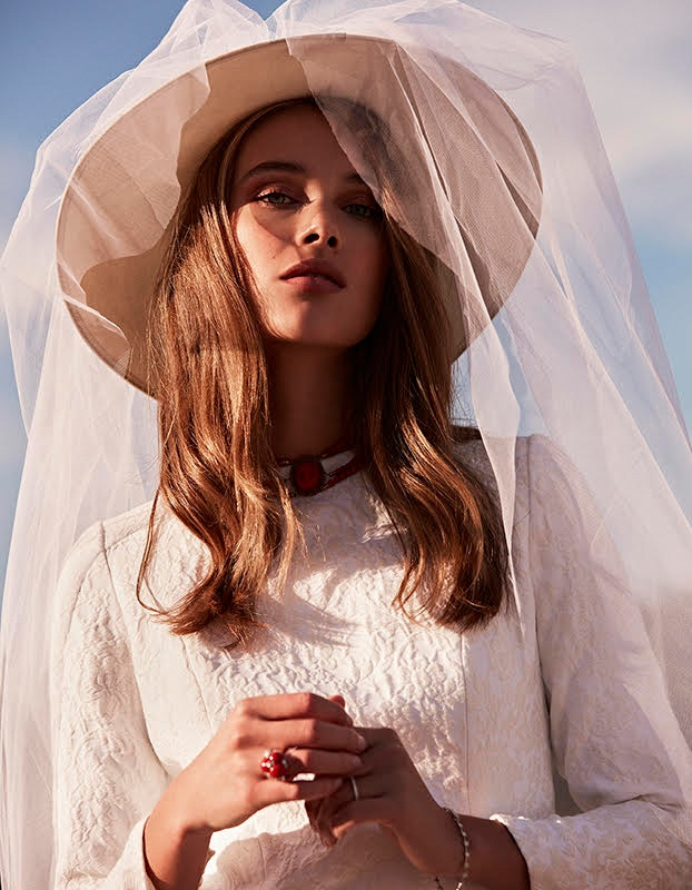 Rozanne Verduin models Maria Barragan dress and Mimoki hat covered with veil