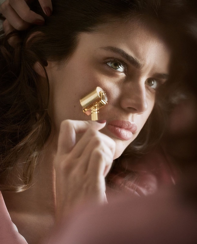 Sara Sampaio uses a gold microneedle roller in this shot