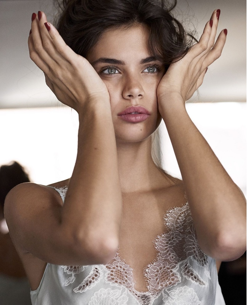 Looking refreshed, Sara Sampaio poses in a lace-trimmed top