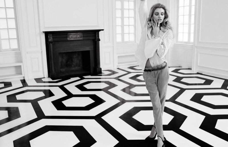 Photographed in black and white, Stella Maxwell models Acne top, Mango pants and Gianvito Rossi heels